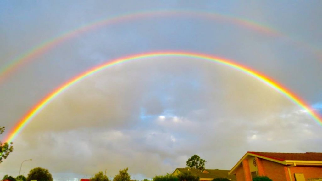 double rainbow over housing
